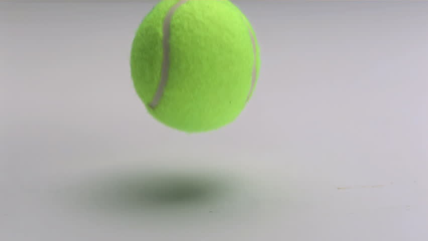 Tennis ball slow motion dropping and bouncing on white background