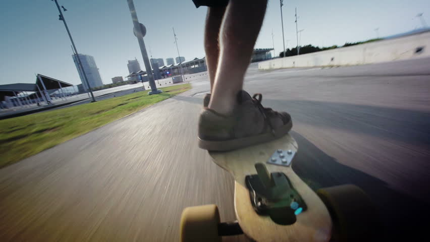 close up of a guy on his longboard skate, back view. Barcelna, Spain