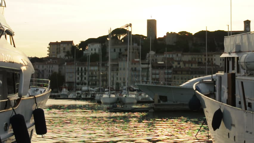CANNES, FRANCE - CIRCA SEPTEMBER 2012: Yachts moored in Cannes at sunset. Cannes bay - HD stock footage clip