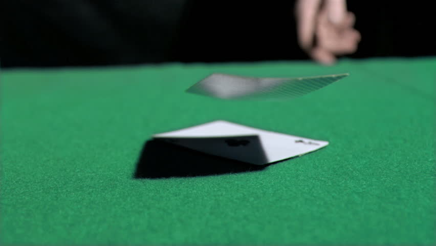 Aces thrown in super slow motion on a poker table
