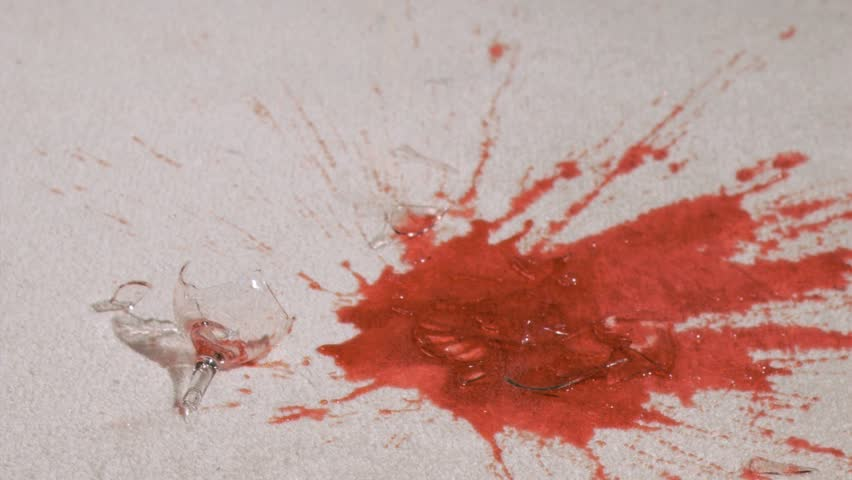 Red wine in super slow motion breaking on the floor
