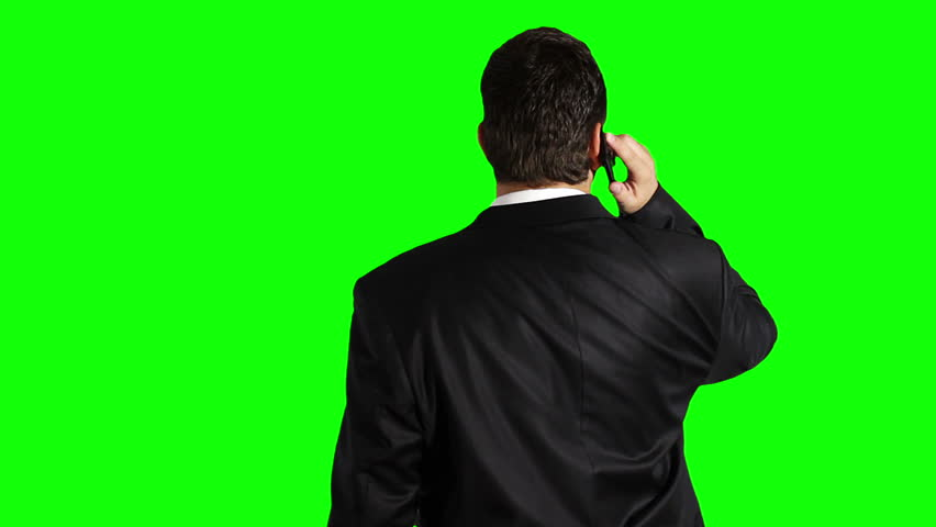 Young Businessman Cell Phone Looking Up Greenscreen  Footage shot against green screen and keyed out. Bg is clean green, removing the it is 1 click. Green spills are removed. - HD stock footage clip