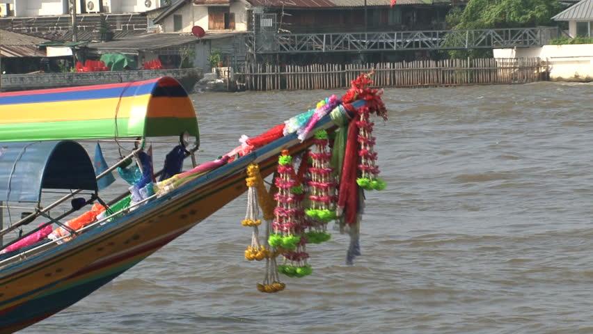 Colorful longtail boats in Bangkok with a small watertaxi at the background at the Chao Phraya River, Bangkok, Thailand - HD stock footage clip