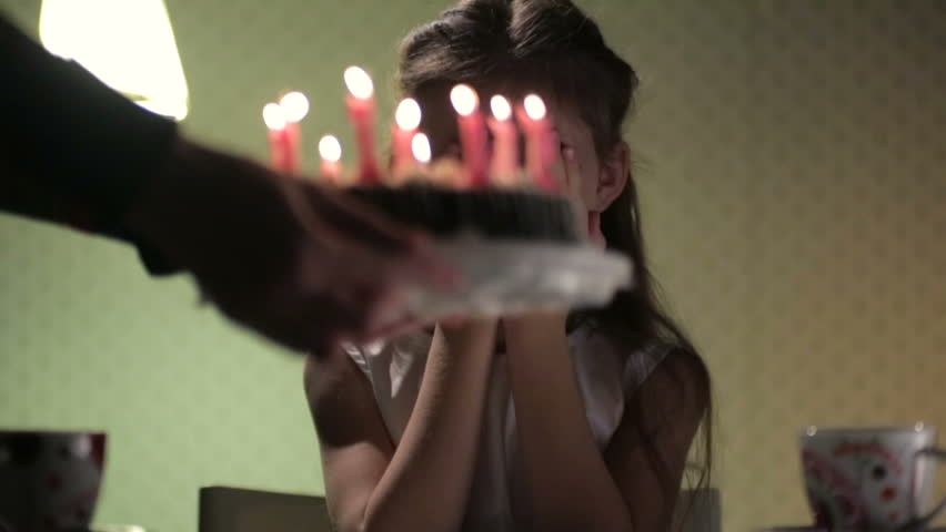 Birthday girl and cake with candles