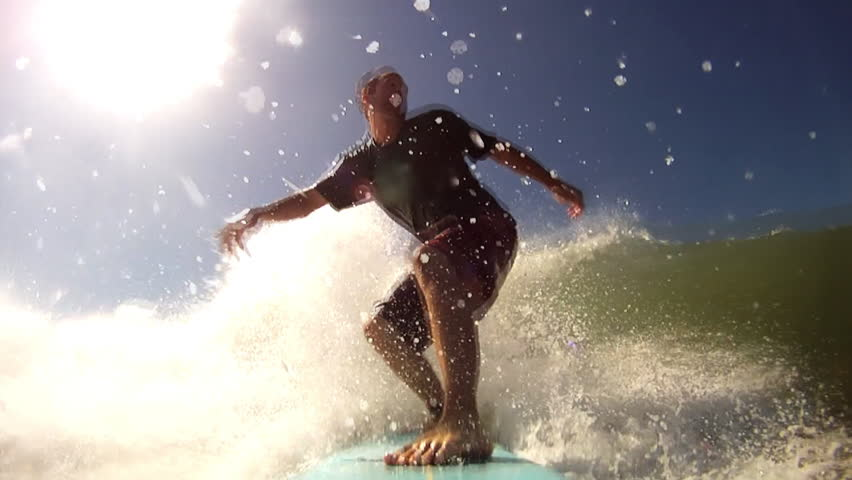 A man surfing in the warm water's of Central America