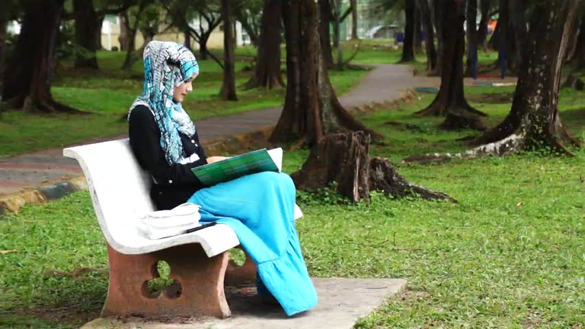 Beautiful muslim lady checking her notebook - HD stock video clip