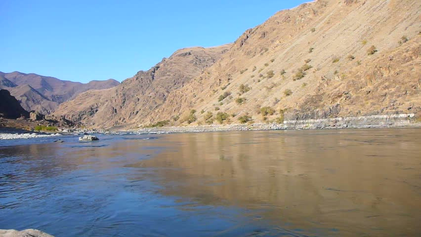 Point of view of person putting on snorkel mask then jumping into Snake River in Hells Canyon.