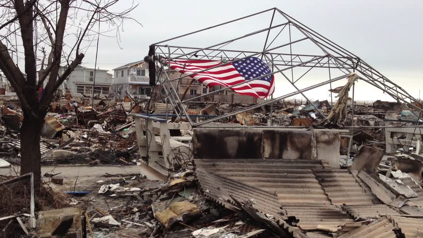 BREEZY POINT, QUEENS, NY-December 2, 2012: Video clip of wreckage and debris from homes destroyed by devastating fire during Hurricane Sandy.  American flag is draped in background of devastation.