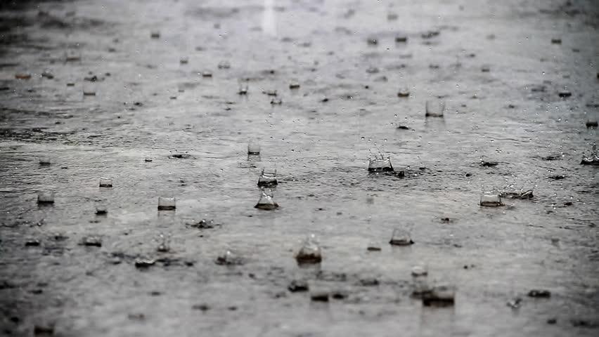 A closeup shot of heavy rain on road - HD stock video clip