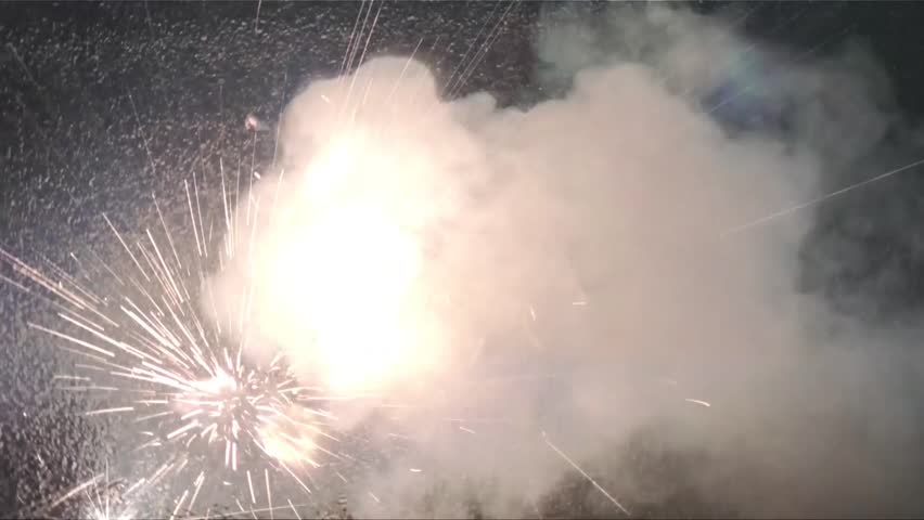 Firework is lit and sparks blast randomly at the camera with the word love in bright colors. - HD stock video clip