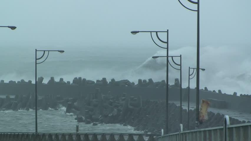 Large Hurricane Waves Crash Into Sea Wall