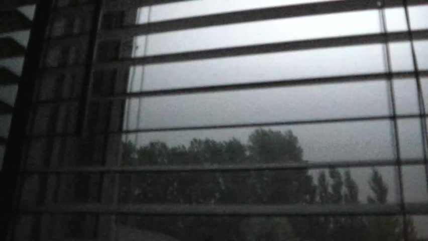 Lightning strikes abundantly through white window blinds in darkened room during summer night. #3293864