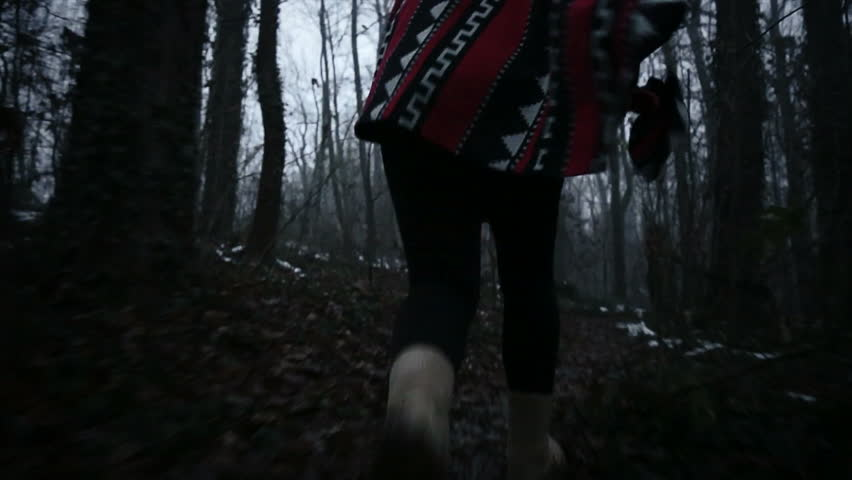 Girl trying to escape of someone who chases her in the forest