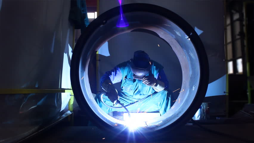 Welder inside Pipe, Welding the Seam to Create One Continuous Section of Pipe.