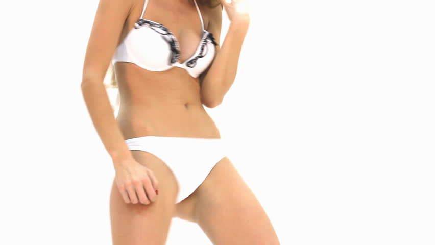 sexy young girl posing against white background - HD stock footage clip