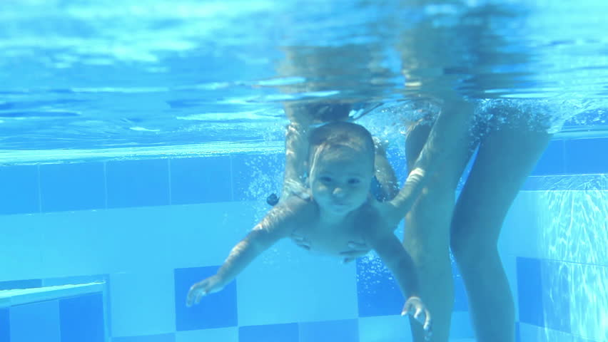 Mother Holding Girl Swimming Under Water Stock Footage ...