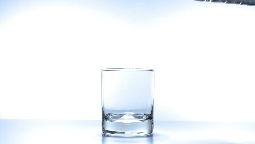 Pouring glass of water in slow motion on white background. fullHD video shot at
