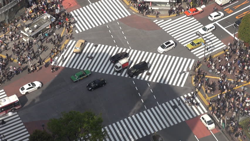 Fast motion of Shibuya pedestrian crossing and car traffic by day, Tokyo, Japan | Shutterstock HD Video #3359330