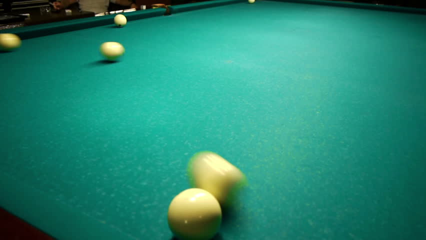 Playing pool, hitting the ball closeup view - HD stock video clip
