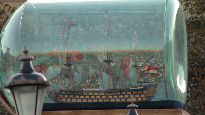 Panning shot, right to left, of a ship inside a bottle, a replica of admiral