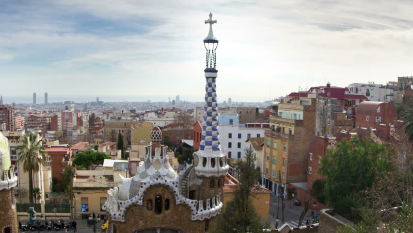 BARCELONA - JANUARY 07: A timelapse shot in Parc Guell, one of the city's major tourist attractions, with the urban skyline in the background, Barcelona, Spain. JANUARY 07, 2013.