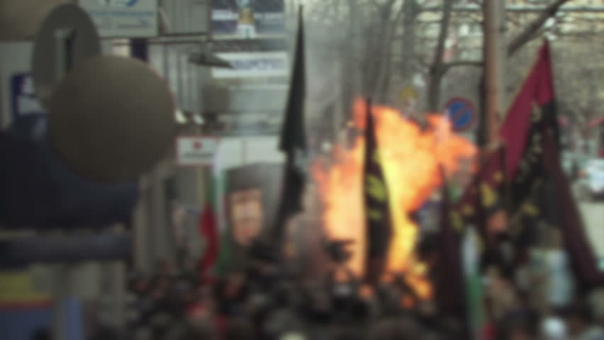 Protesters in Eastern Europe start a fire.