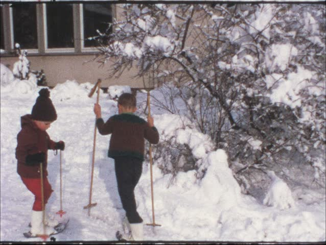 Vintage 8 mm film: Children on ski, 1970s - HD stock footage clip