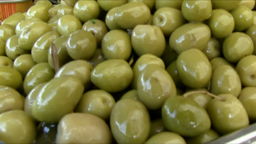 Olives.  Different types of olives neatly stacked on the counter. Healthy food.