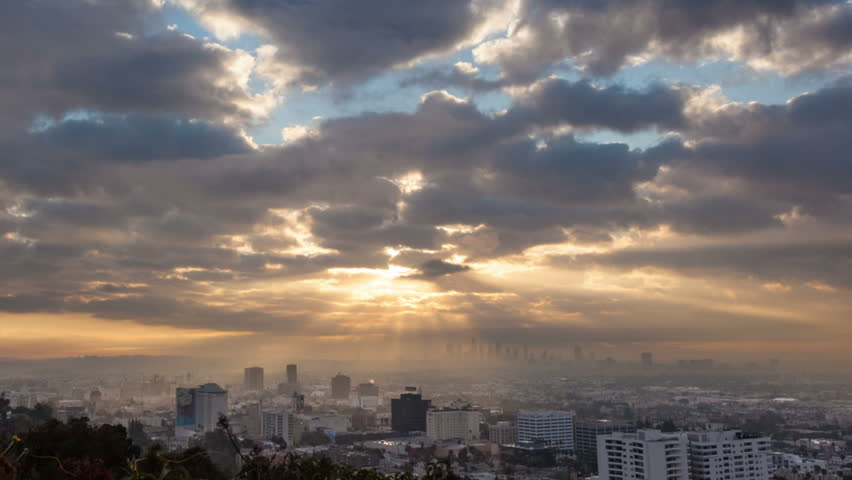 Sunrise over Los Angeles cityscape. Zoom in on downtown. Timelapse.