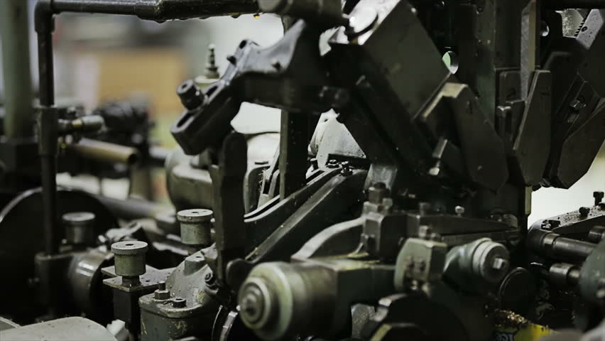 The  old machinery works high speed the turned parts in industrial manufacturing - HD stock footage clip
