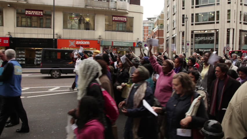 LONDON - OCTOBER 8, 2011: Parade of unidentified people walk in the street