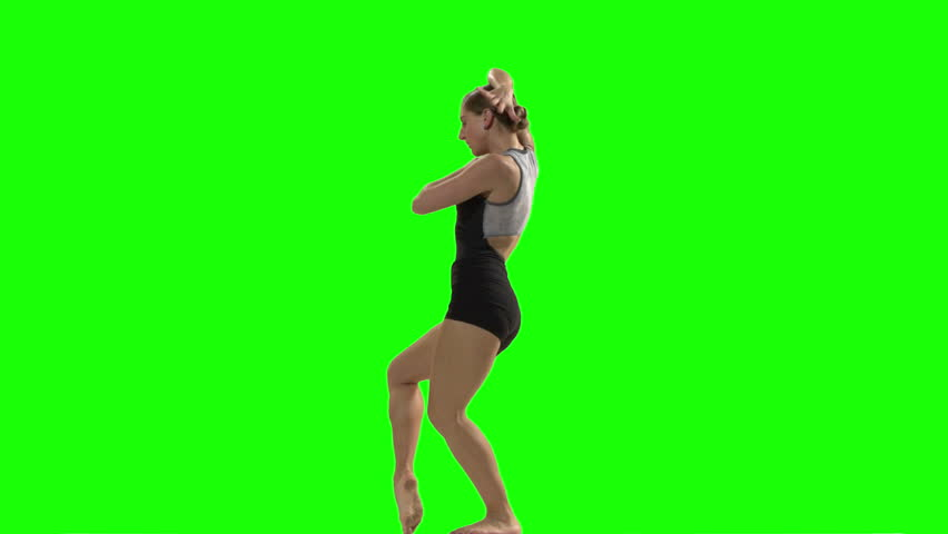 Young woman doing a modern dance piece in front of green screen - HD stock footage clip