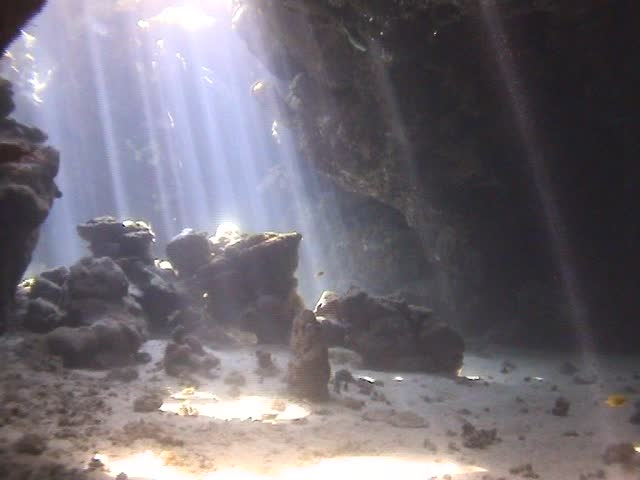 Dramatic underwater caves with light shimmering through - SD stock footage clip
