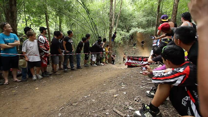 SANKAMPANG, CHIANGMAI, THAILAND - OCTOBER 21:   Unidentified downhill mountain biker crash in long jump downhill in Chiangmai Downhill Challenge Event on October 21, 2012 in Chiangmai, Thailand.