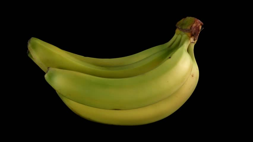 Bunch of Bananas rotating on black background - Looping - HD stock footage clip