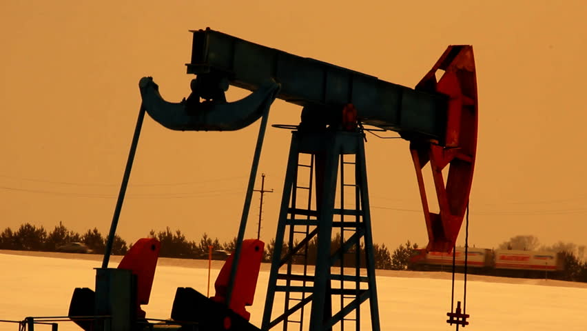 Oil production. Oil pumps at sunset - HD stock video clip
