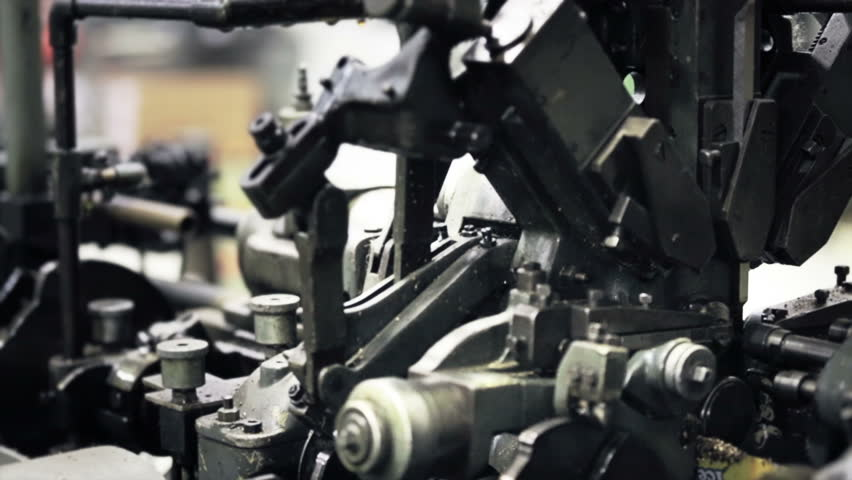 The machinery works in slow motion turned parts in industrial manufacturing - HD stock footage clip