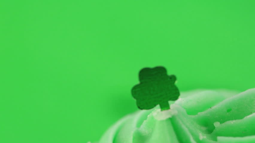 Zoom in on st patricks day cupcake on green background - HD stock video clip
