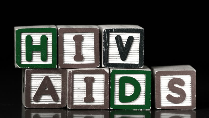 Condom falling on blocks spelling Aids and Hiv in slow motion - HD stock footage clip