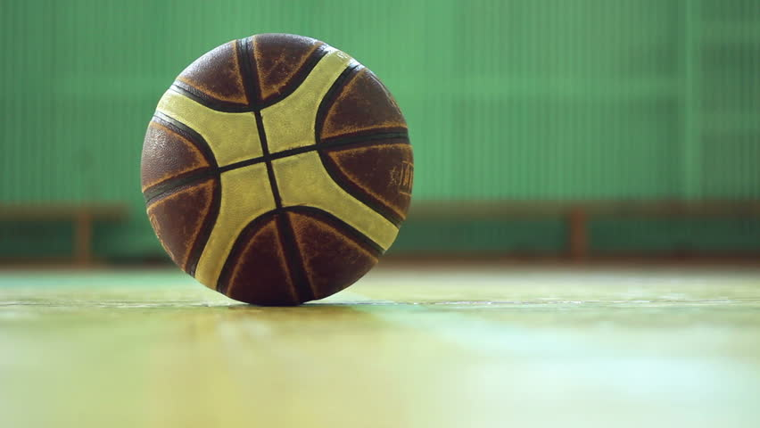 man picking up ball from the floor - HD stock footage clip