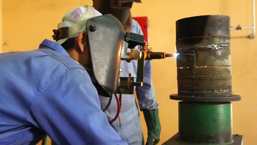 two worker cutting the steel pipe - HD stock video clip