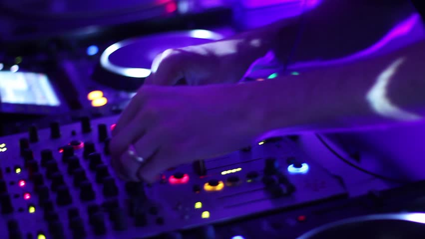Hands of DJ tweak various track controls on dj's deck, camera is breathing | Shutterstock HD Video #3552848