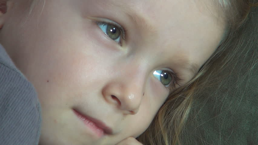 Child Watching TV, Sleepy Little Girl Lying on Bed, Coach, Close Up, Children  - HD stock video clip