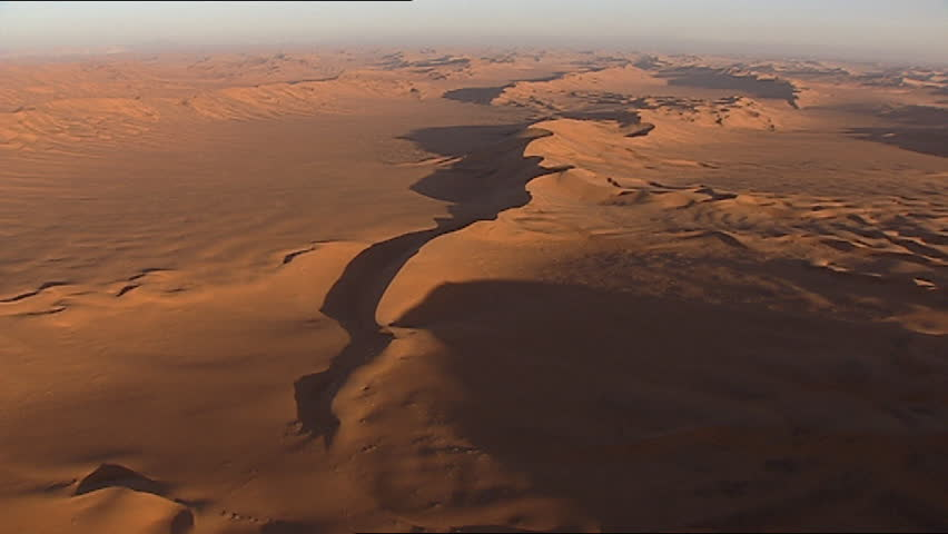Aerial of desert sand dunes - SD stock footage clip
