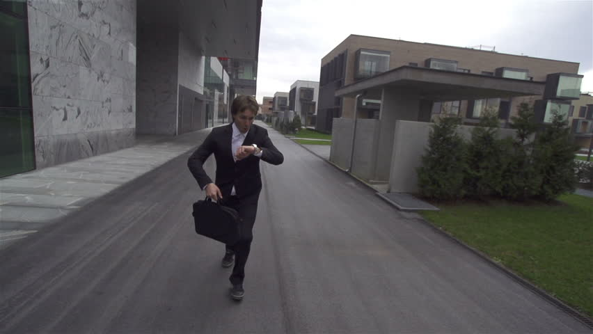 SLOW MOTION: Businessman running late - HD stock footage clip