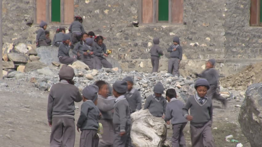 ANNAPURNA REGION, NEPAL – CIRCA OCTOBER 2011 – Students are playing outside the school during break circa October 2011 in Annapurna region in Nepal. - HD stock video clip