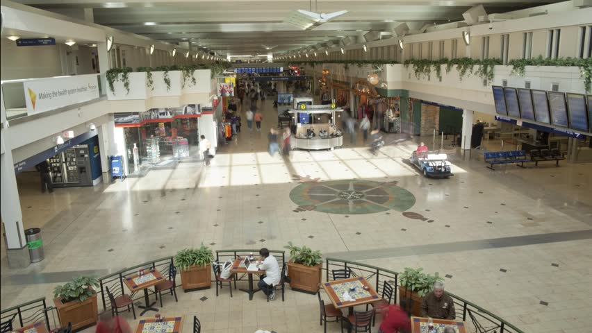 Indoor Airport time-lapse with people crowds cart trail effect