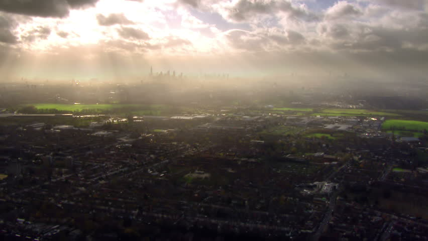 Panoramic and dramatic aerial view over the outskirts of London, England where the sprawling urban metropolis meets  the countryside.