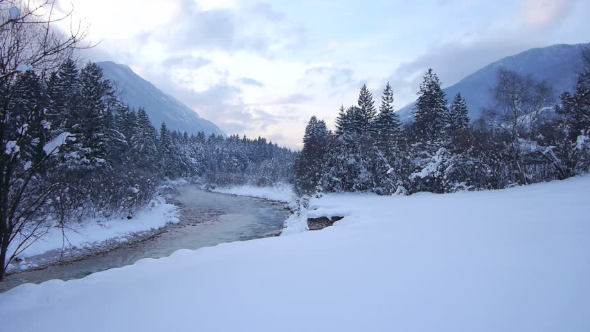 AERIAL: Misty river in winter