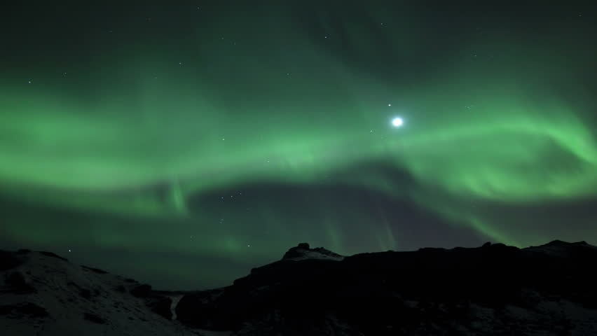 Northern Lights in Lava Field, Reykjavik Iceland. Tourists can be seen walking on the lava field with the aurora overhead #3599720
